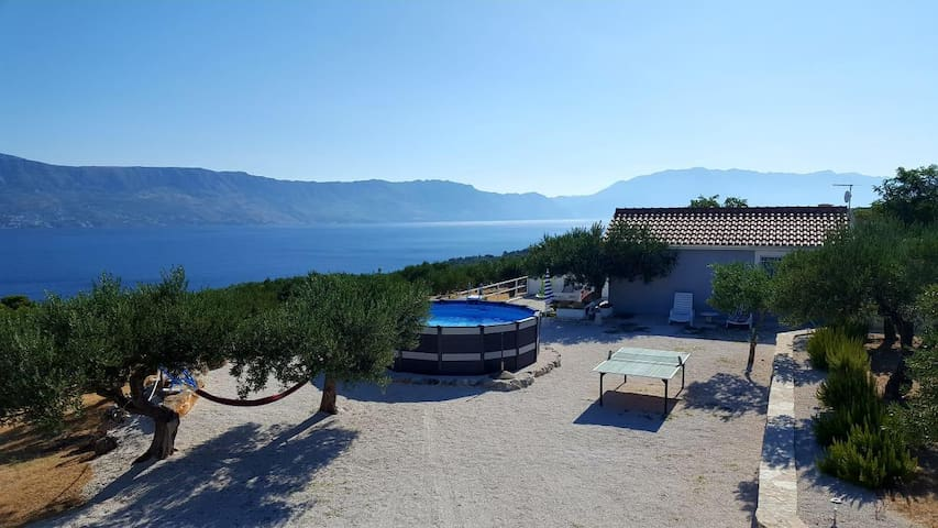 Two bedroom house with terrace and sea view Postira (Brač) (K-11742)