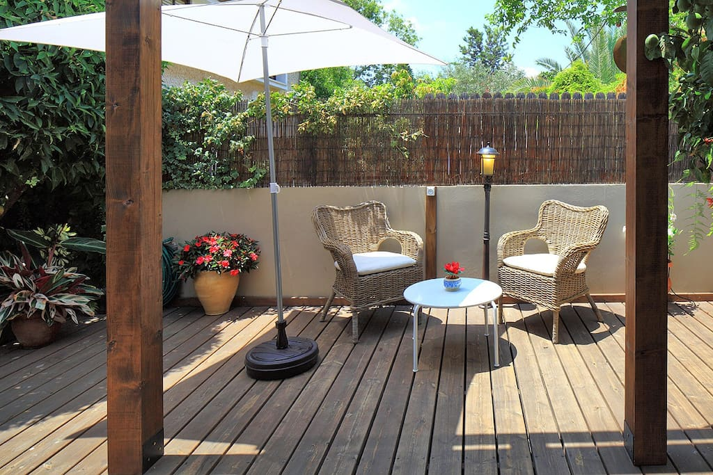 Wooden terrace surrounded by a green garden for you,