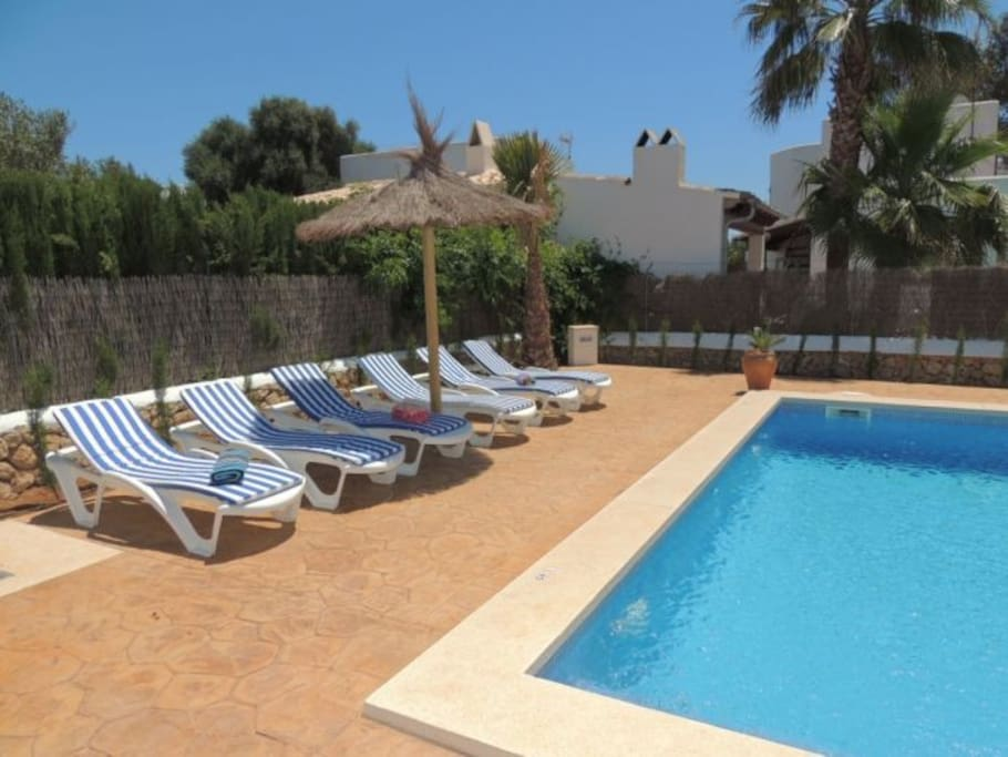Pool with comfortable sun loungers