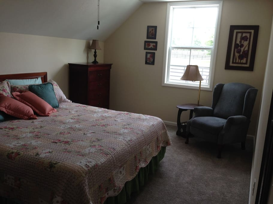 Comfy king sized bed in spacious bedroom