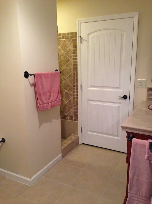 Spacious bathroom with shower (no tub)