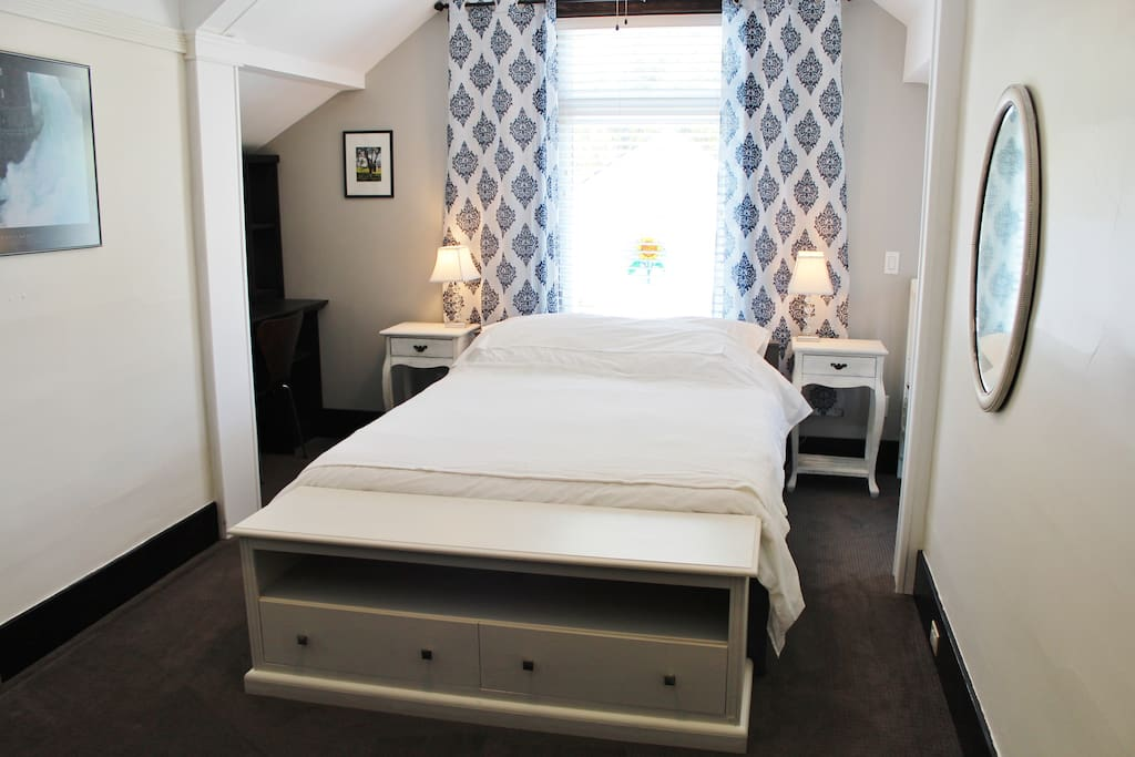 Bright and spacious bedroom with queen bed