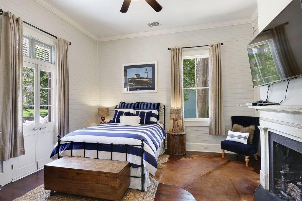 Front Bedroom with Queen bed and French Door opening onto Front Porch