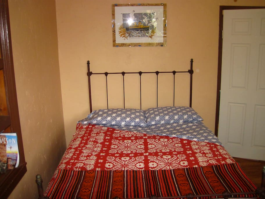 Restored antique iron bed with queen mattress