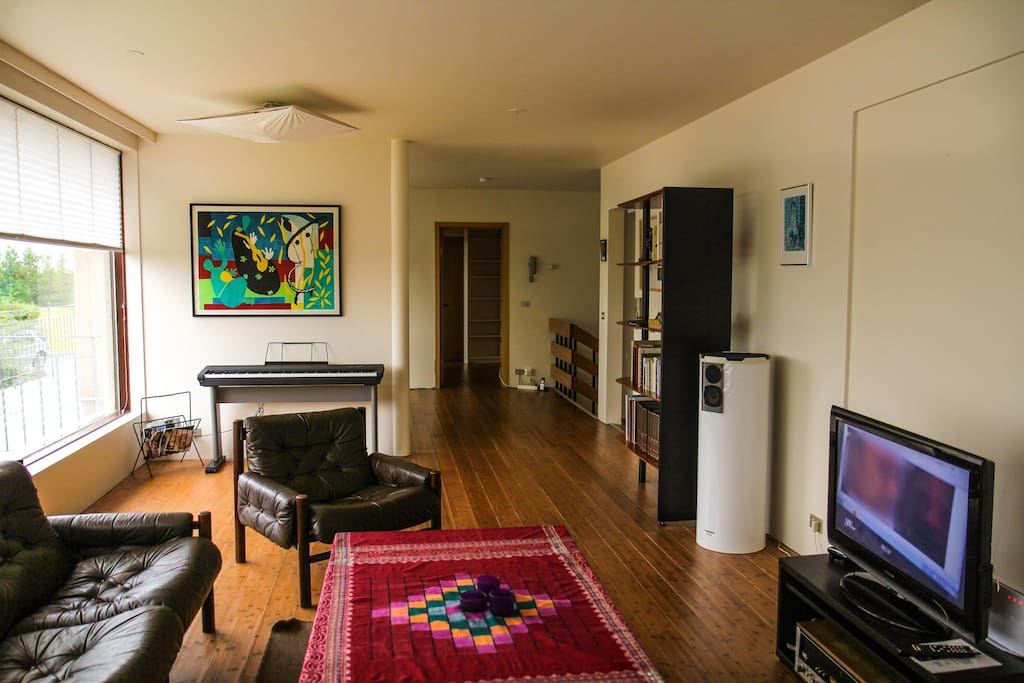Living room on second floor.  Cable TV, Internet and landline telephone calls are free!