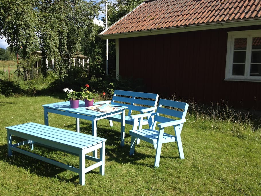 Sky blue furniture. Lovely place for having breakfast, lunch or dinner, or all of them...