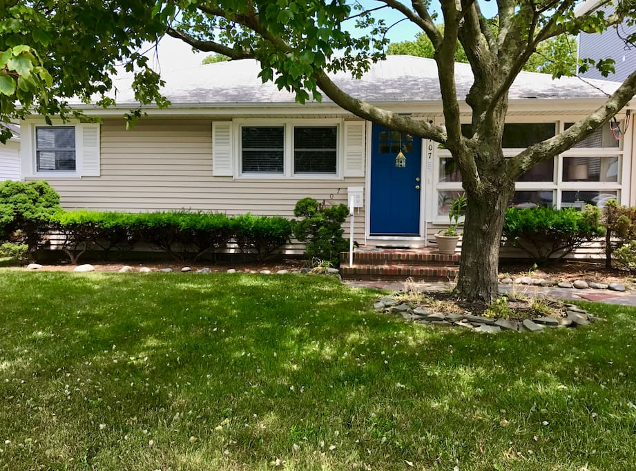 Look for the bright blue door under the shade in this newly-updated beach house!