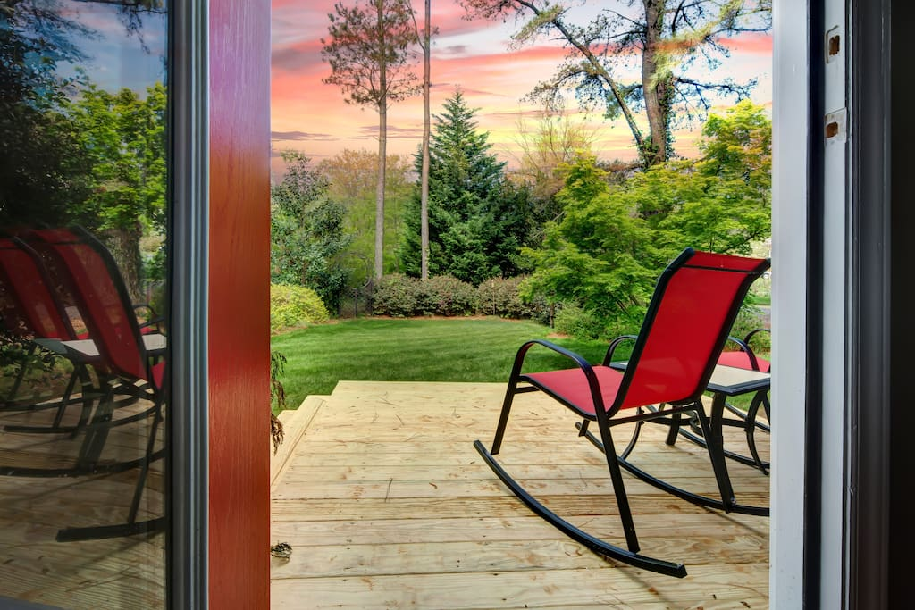 View looking out onto the deck which faces west/great sunsets...