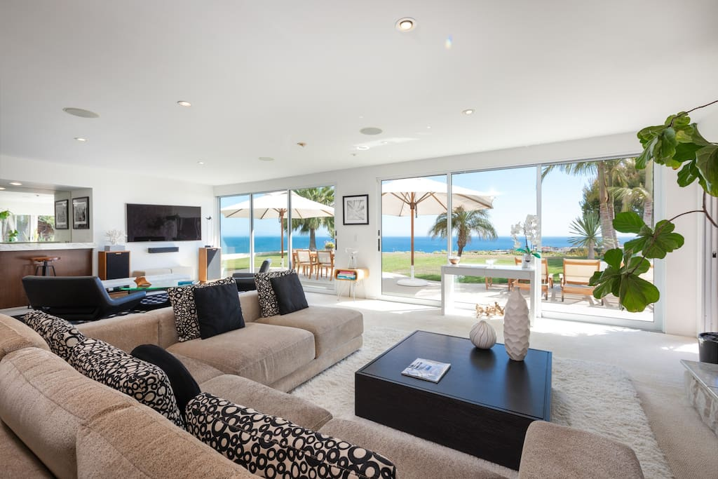 A 7-person sectional in living room looks out to the panoramic ocean views.