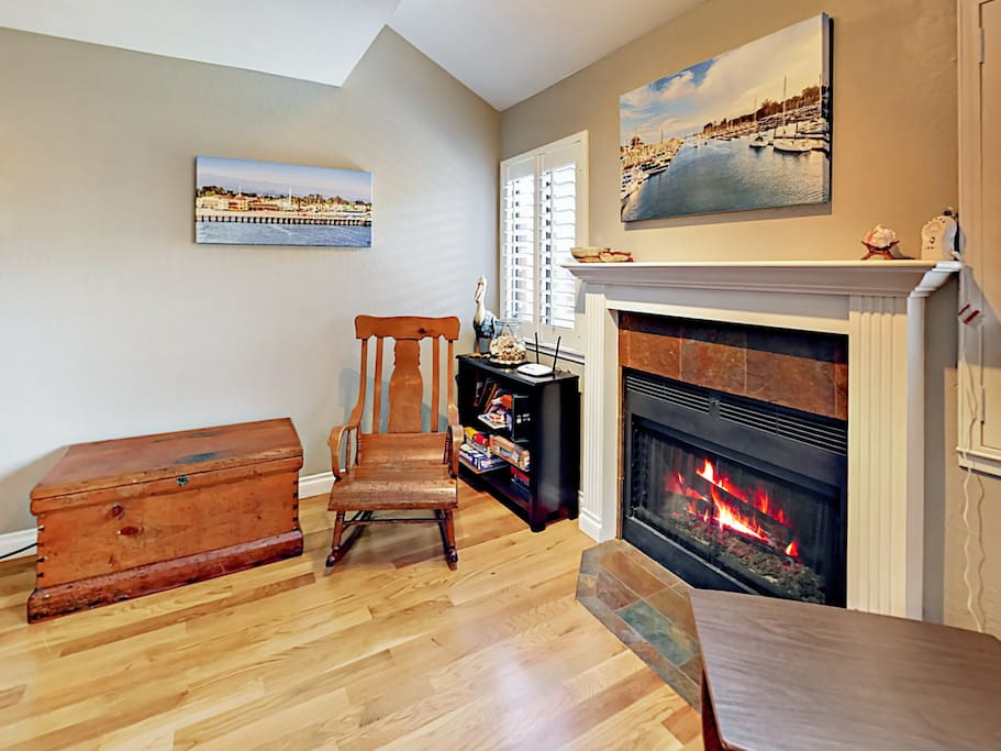 Enjoy the warm ambiance of the gas fireplace in the main living room.