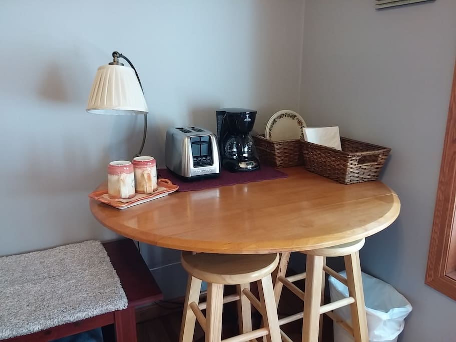 Your room has a small table you can work at, with a toaster, a coffee maker, and light breakfast provisions (bread and English muffins, and individual jams and honey).