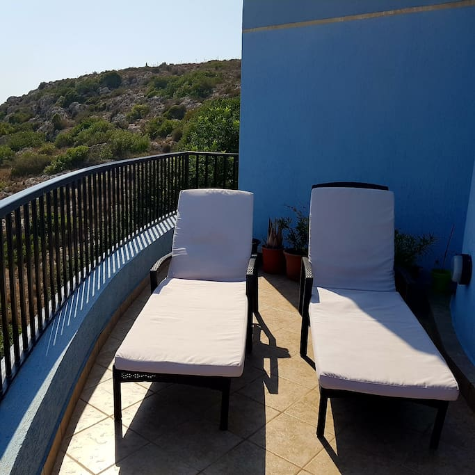 Large main terrace with sea and country views  - sunbeds