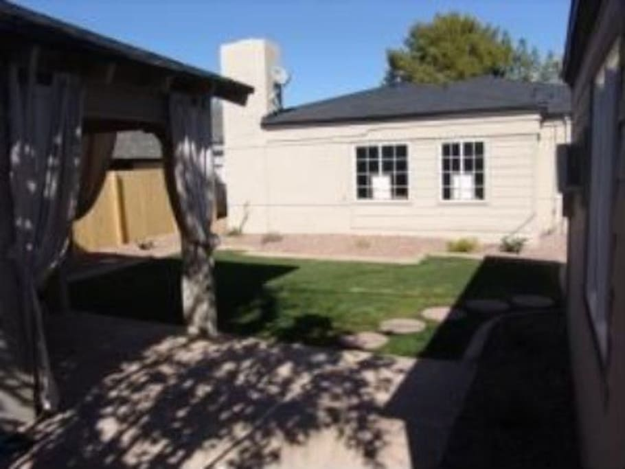 Backyard with area to grill. Outdoor sitting furniture available.