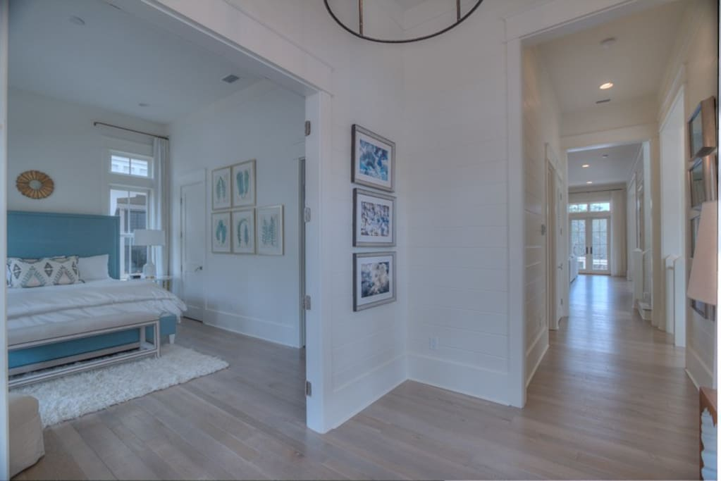 Large main entrance to home with views straight back to the open living space and king bedroom to the left