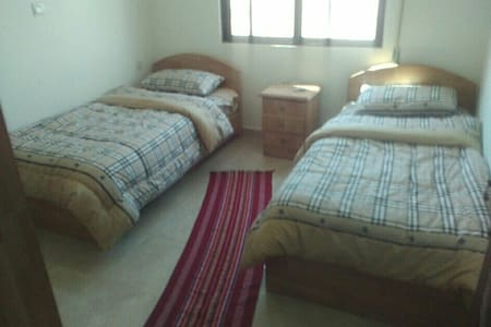 Cozy two beds in aprivate room .