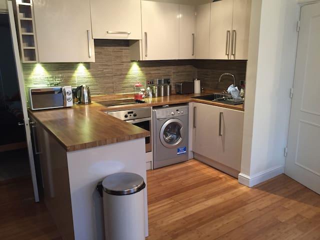 Open plan kitchen with washer/dryer