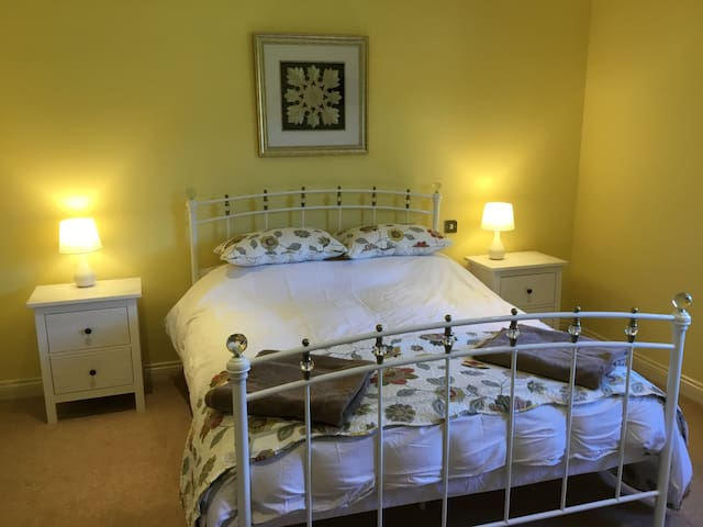 Comfortable Kingsize Bed with large walk-in wardrobe