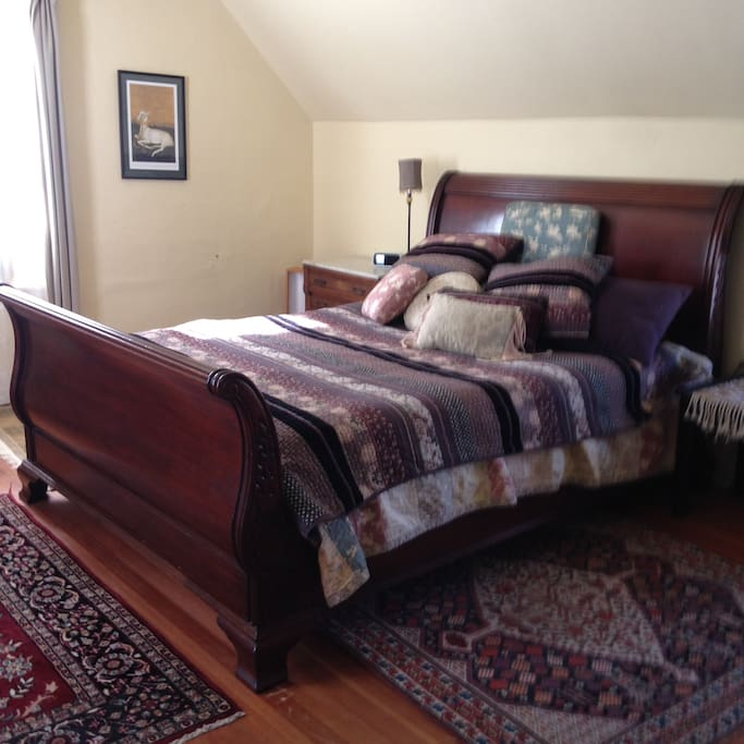 Master bedroom has a comfortable queen size sleigh bed and plenty of charm.