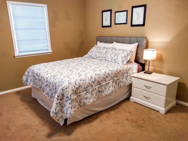 Bedroom #2 features a queen bed and a walk-in closet. Shares the hall bath with Bedroom #1.