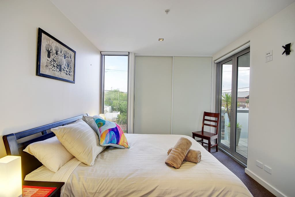 The main bedroom opens to the balcony, has loads of storage and has an ensuite bathroom