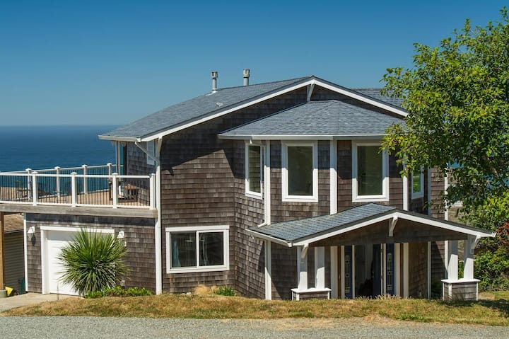Perched high above Rockaway Beach this home has amazing views of the coast!