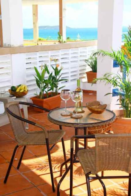 Enjoy outdoor dining in the spacious private sunny airy deck with Caribbean Sea views.