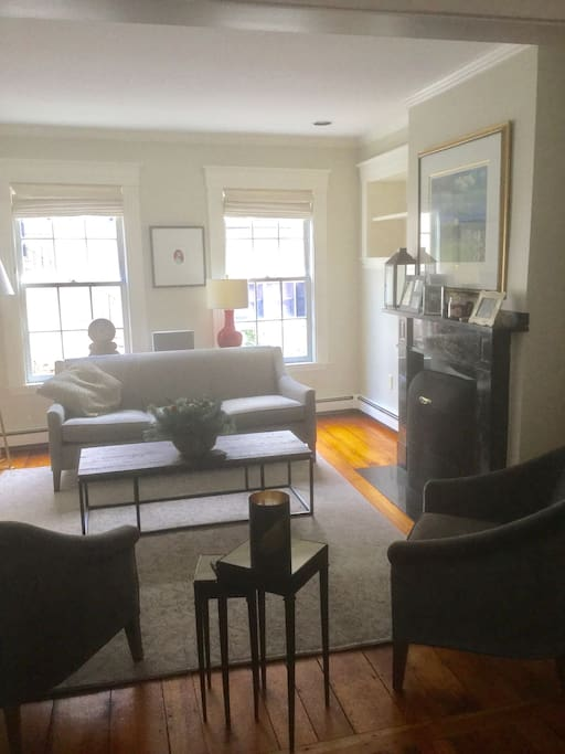 Lovely sitting room with original fireplace and lots of natural light