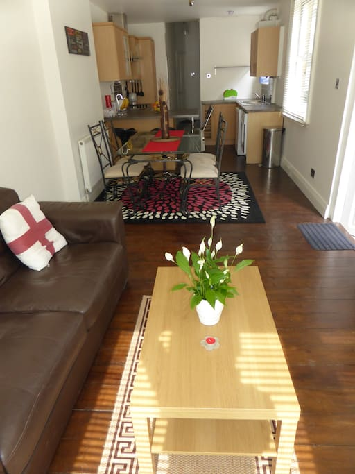 Living room, dining room, kitchen all in one long sunny bright room with exit into the garden