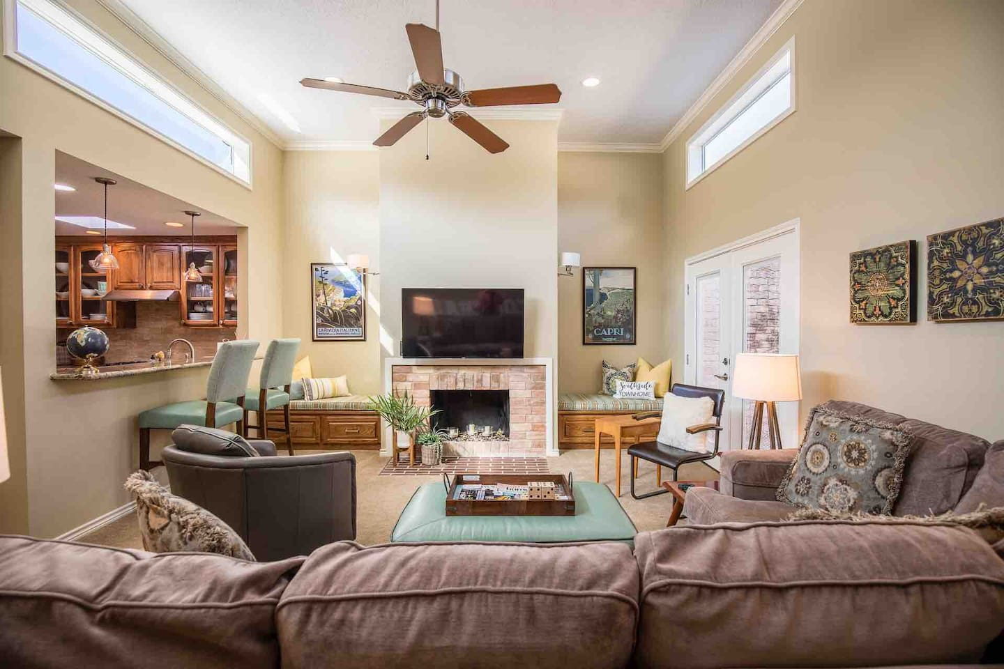 Spacious, sunlit living room with courtyard access and custom furnishings. Designed for relaxing and visiting with friends and family.  Vintage pieces add personality to the California contemporary space.
