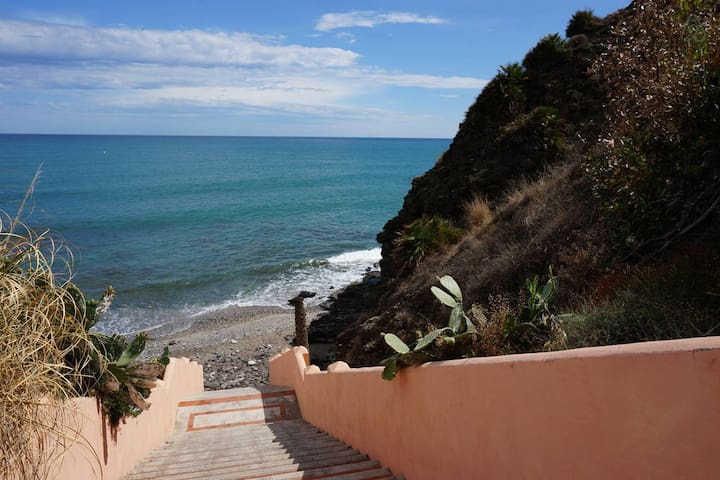 Steps down to the beach from pool-area