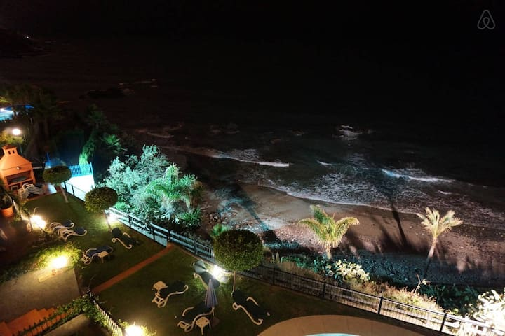 Pool area and beach at night