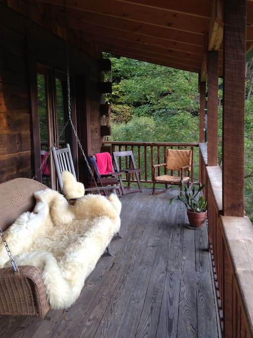 Shared deck with rocking chairs and view of Three Top Mountains.