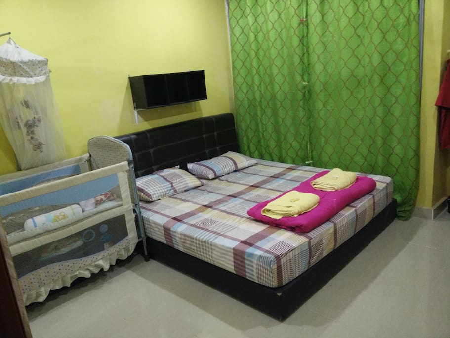 master bedroom - king size & baby cot