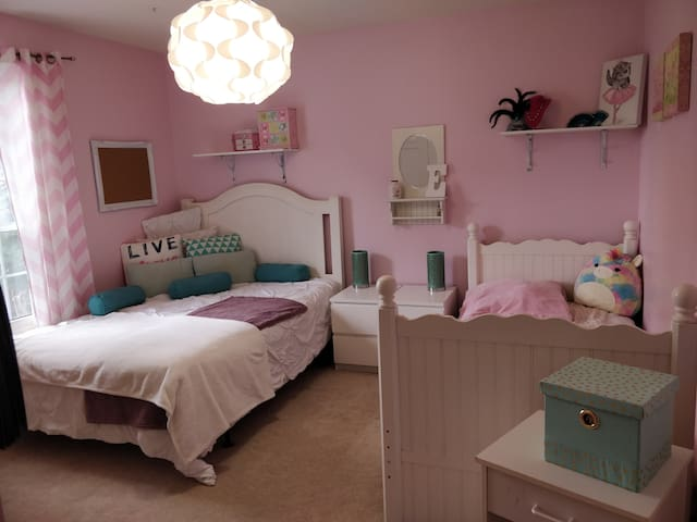 Second main floor bedroom with double and single beds.