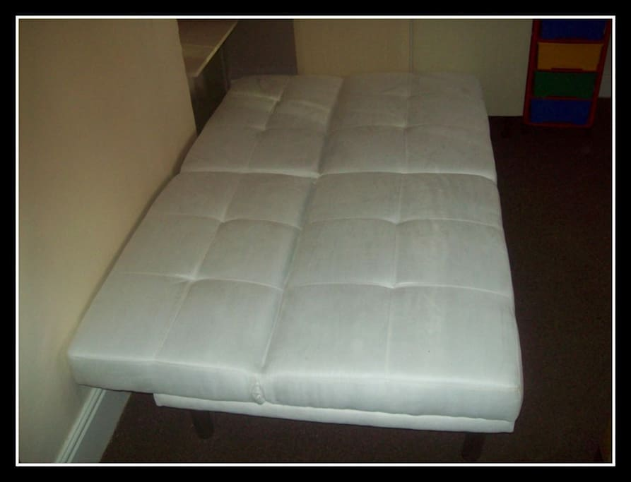 The sofa converted to a bed