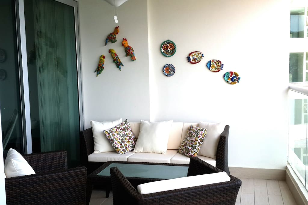 Beautiful ceramic birds and plates adorn our furnished balcony area that goes the entire front of the apartment. It's your second living room.