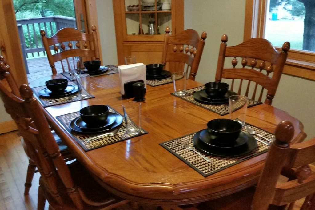 Although this table shows a setting for six there is an extra leaf to expand the table.   There is also a set of four t.v. trays for additional dining space.