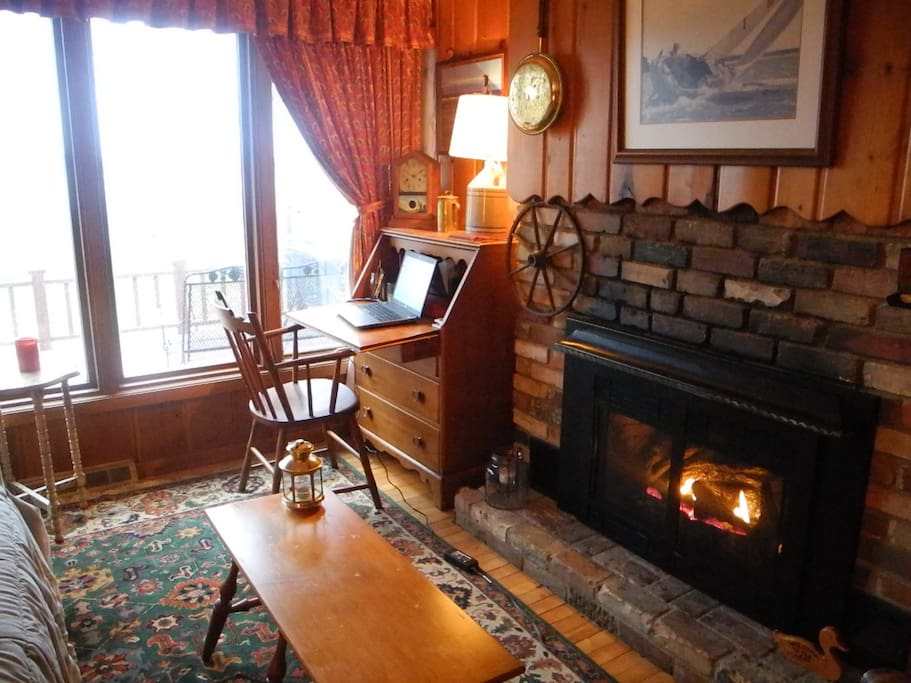A cozy warm space for sitting by the fire, writing at your desk, or gazing at the lake.