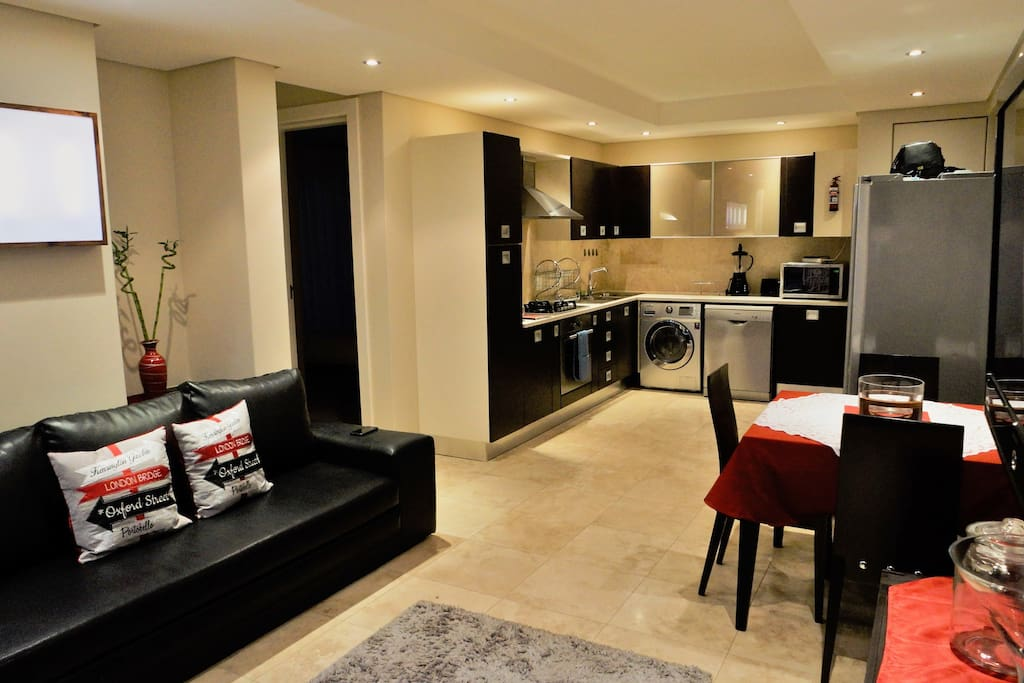 Lounge and kitchen - the couch is a sleeper couch - Underfloor heating in winter months