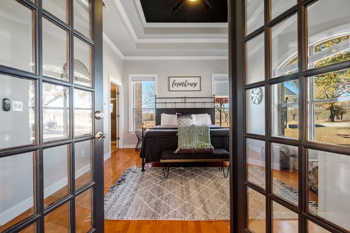 Master suite with french doors leading to wrap around porch