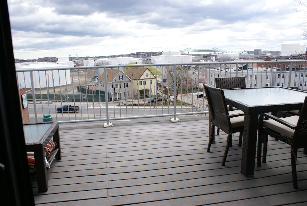 Spacious outdoor deck with outdoor furniture and spectacular view.