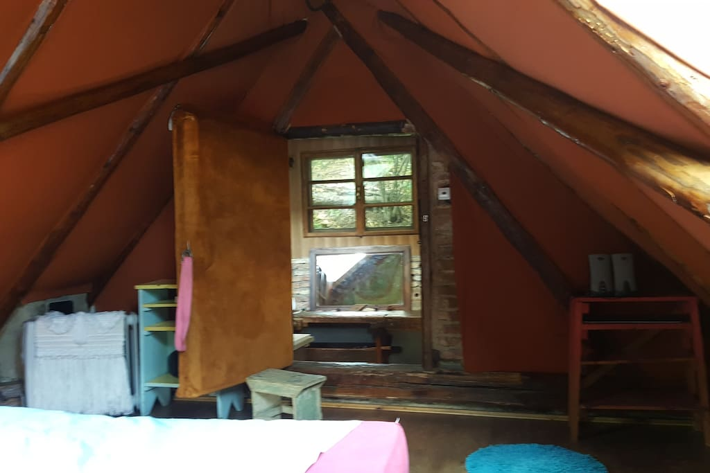 View from laying in your handmade Queensize bed.No, it's not an indian teepee nor a mongol yurt, it's just a cozy place we handcrafted for special people, like us and yoo :))