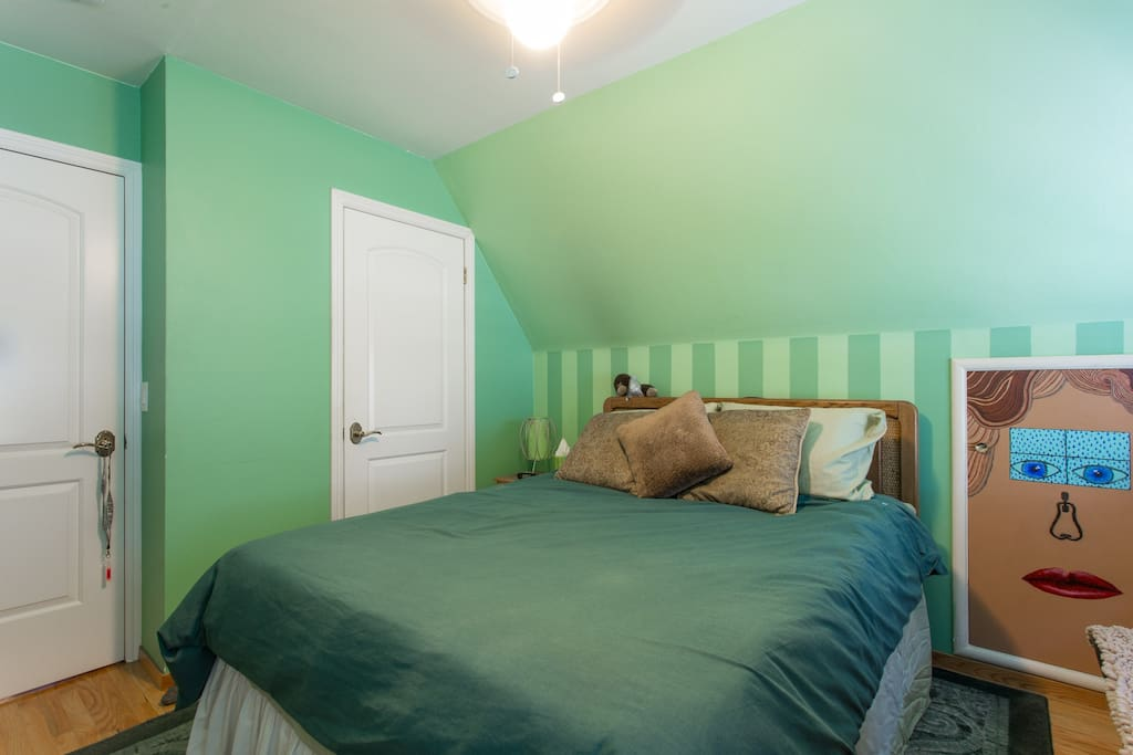 One of two upstairs bedrooms. Queen bed dresser and armoire.
