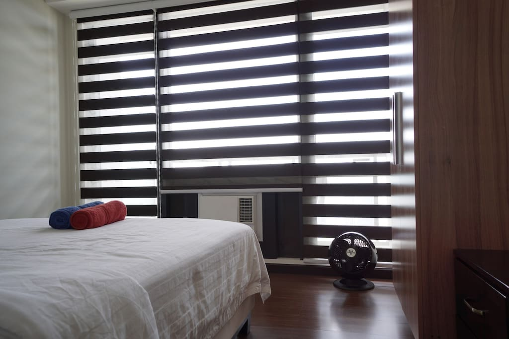 Bedroom with black and white combi-blinds.