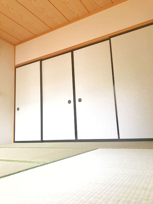 Guest room with Tatami mat and Fusuma which is traditinal paper doors