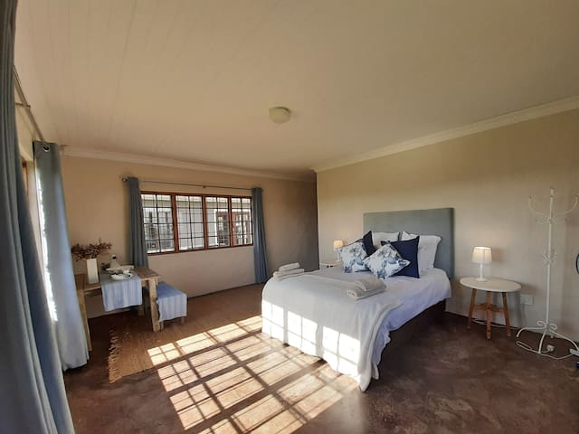 Master bedroom with a queen size, extra length bed with beautiful view of the berg