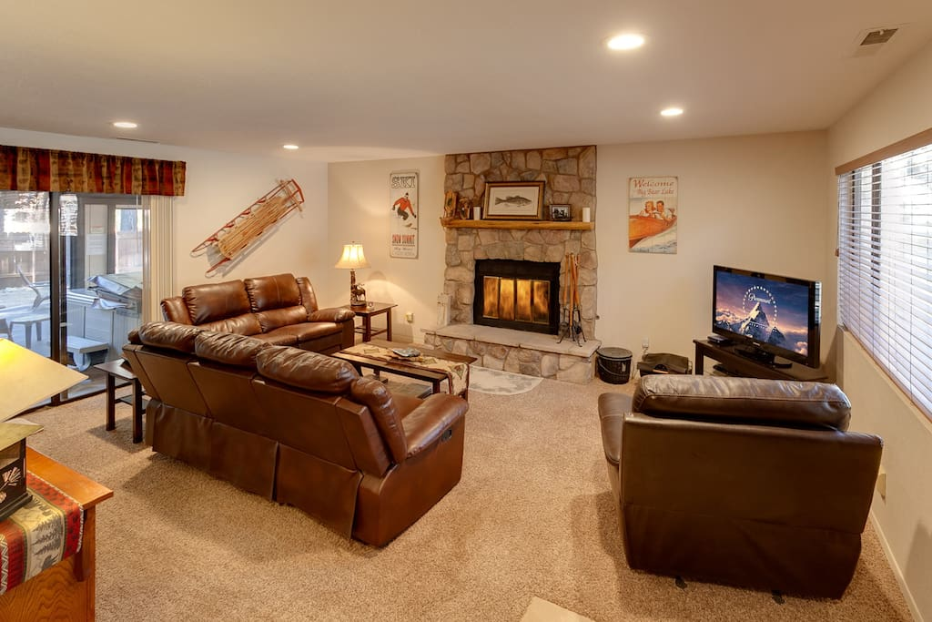 Spacious open living area with wood burning romantic fireplace and LCD TV with Charter Cable and Wifi.