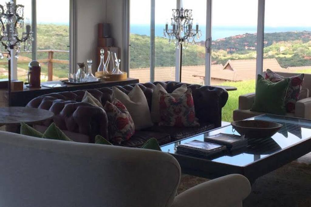The lounge which opens onto a garden with views to Durban