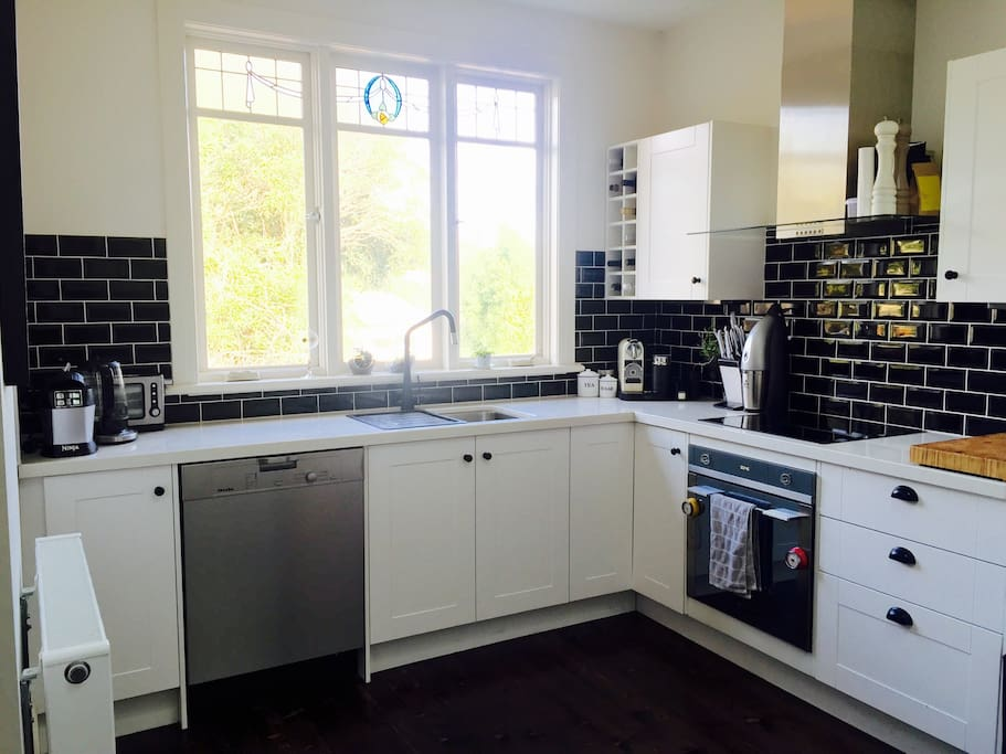Our gorgeous kitchen with dishwasher and nespresso machine.