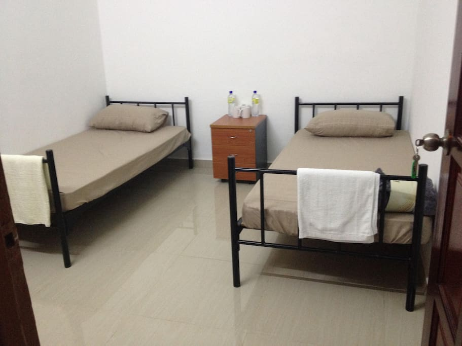 2  Twin Sharing Single Beds     ( External Bathroom - Hot Shower)